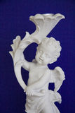 Cupid on blue Stock Image