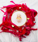 Cupid on the center in to surround with of natural materials Royalty Free Stock Photography