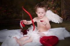 Cupid con el arqueamiento y la flecha Imagenes de archivo