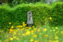 Cupid couple in a flower garden. Royalty Free Stock Photo