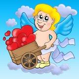Cupid de sorriso com wheelbarrow Foto de Stock Royalty Free