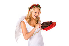 Cupid: Eating Candy From Heart Shaped Box Stock Photo