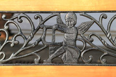 Cupid Figure decorated on wooden chair Stock Photos