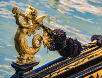 Cupid on Gondola. Detail of a golden cupid on a gondola in Venice, Italy royalty free stock images