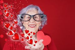 Cupid grandma Valentine`s or love card. Comical cupid grandma Valentine`s or love card with hearts and bokeh stock images