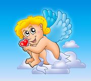 Cupid with heart on blue sky Royalty Free Stock Photos
