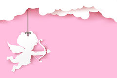 Cupid holding arrow with shadow on pink background with copyspac Stock Photos