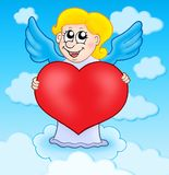 Cupid holding heart on sky Stock Photo