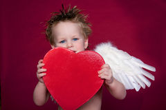 Cupid Laughing. Cupid holding up heart shaped box, good place for text, good for valentines design stock photos