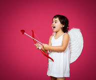 Cupid little girl Stock Image