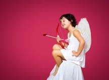Cupid little girl Stock Photos