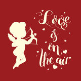 Cupid Love silhouette with bow and arrow and Love is on  Royalty Free Stock Image