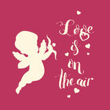 Cupid Love silhouette with bow and arrow and Love is on  Stock Images