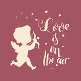 Cupid Love silhouette with bow and arrow and Love is on  Stock Photography