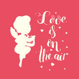 Cupid Love silhouette with harp and Love is on the air Royalty Free Stock Image