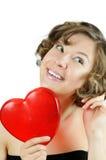 Cupid-muchacha rizada linda con el corazón fotografía de archivo