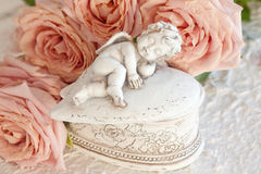 Cupid with Pink Roses Stock Photography
