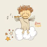 Cupid playing the flute Royalty Free Stock Photos