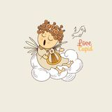 Cupid playing the harp Royalty Free Stock Image