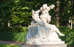 Cupid and Psyche. The Copy Marble sculpture of Cupid and Psyche (by Giulio Kartar probably, XVII century) in old park Summer garden in St.Petersburg, Russia Royalty Free Stock Images