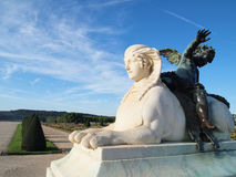 Cupid ride Sphinx at Versailles castle France. Sphinx and Cupid Statue at Versailles castle in France Royalty Free Stock Photos