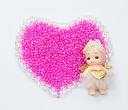Cupid on the right on crystal and beads valentine hearts Stock Image