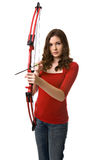 Cupid's arrow. Beautiful young woman aims a bow and arrow at seekers of romance Royalty Free Stock Image
