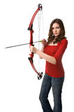 Cupid's arrow. Beautiful young woman aims a bow and arrow at seekers of romance Royalty Free Stock Images