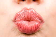 Cupid's bow. Close up shot of young woman making her lips cupid's bow Royalty Free Stock Photography