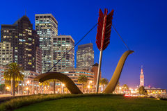 Cupid's Span in San Francisco. SAN FRANCISCO, USA - January 8: Cupid's Span statue by Claes Oldenburg and Coosje van Bruggen with the city as a backdrop, on Stock Photos