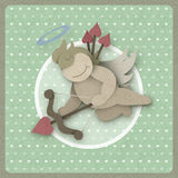Cupid shoot bow love heart on vintage background, recycled paper Royalty Free Stock Image
