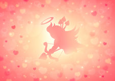 Cupid shoot love bow on blur red heart bokeh for valentine Royalty Free Stock Photo