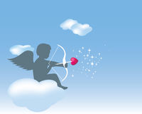 Cupid sitting on a cloud with his bow and arrow Stock Image