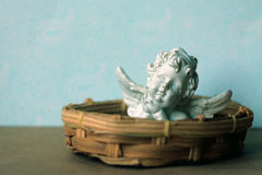 Cupid. Small cute white ceramic cherub Stock Image