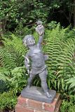 Cupid Statue. A statue of cupid holding a heart Stock Images
