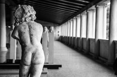Cupid statue. Back of an ancient cracked cupid statue in black-white tone Royalty Free Stock Images