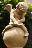 Cupid Statue Closeup. A Statue of Cupid Royalty Free Stock Photos