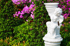 Cupid statue. In the garden with bougainvilleas flower stock photography