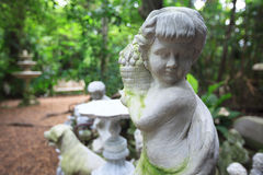 Cupid Statue sculpture in the garden. Royalty Free Stock Image