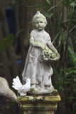 Cupid Statue sculpture in the garden. Royalty Free Stock Photography
