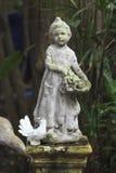 Cupid Statue  sculpture in the garden. Cupid Statue sculpture in the garden Royalty Free Stock Photography