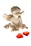Cupid with two red hearts Royalty Free Stock Images
