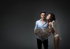 Cupid in a Valentine's day action Stock Images