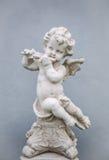 Cupido com flauta foto de stock royalty free
