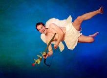 Cupido met haard gevormde pijl royalty-vrije stock afbeeldingen