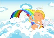 Cupido que senta-se ao lado do arco-íris Foto de Stock