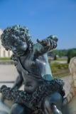 Cupidon古铜色雕象在凡尔赛,法国 库存照片