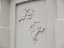 Cupidon de soulagement de bas d'anges images libres de droits