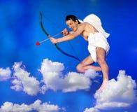 Cupidon de vol photographie stock