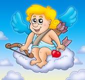 Cupidon heureux sur le ciel Image stock